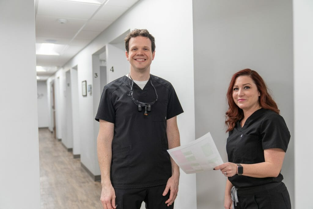 Dr. Hickey and team member smiling in hallway